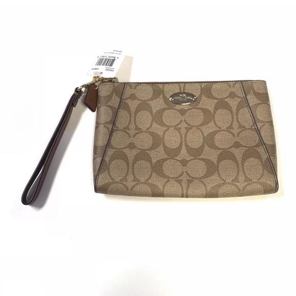 Coach Handbags - NEW Coach Clutch Wristlet Signature C PVC Morgan